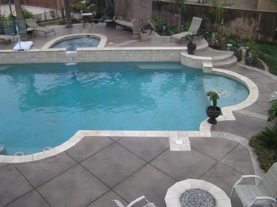 Elegant-pool-deck-stamped-concrete-with-furniture-design.jpg