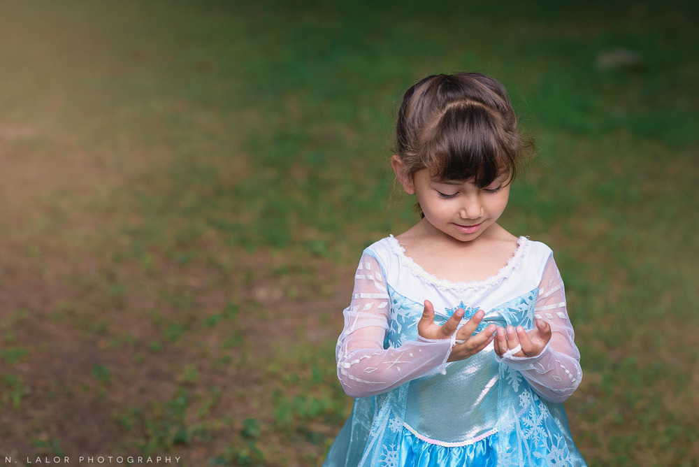 Georgia playing dress-up as Elsa from Frozen: a mini portrait session in Weston, Connecticut by N. Lalor Photography.