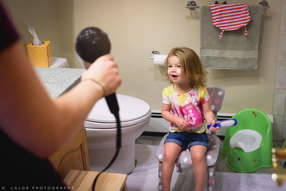 Watching Mom blow dry her hair in the morning. Documentary photo by N. Lalor Photography.
