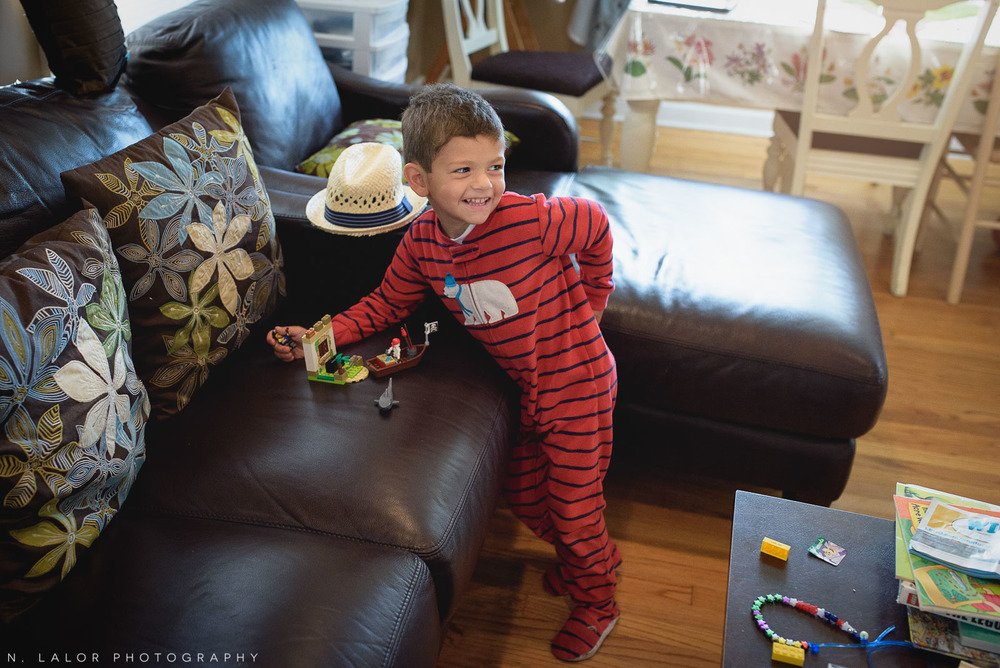 4-year old boy playing with Legos. Documentary photo by N. Lalor Photography.