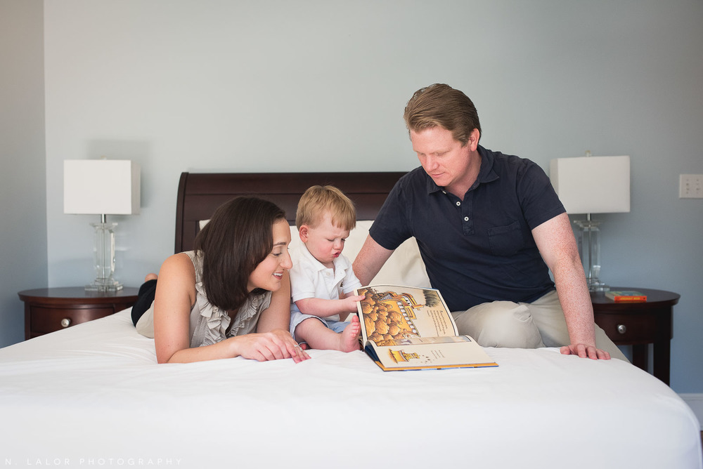 Lifestyle photo of a family reading together. Naturally styled family photo by N. Lalor Photography.