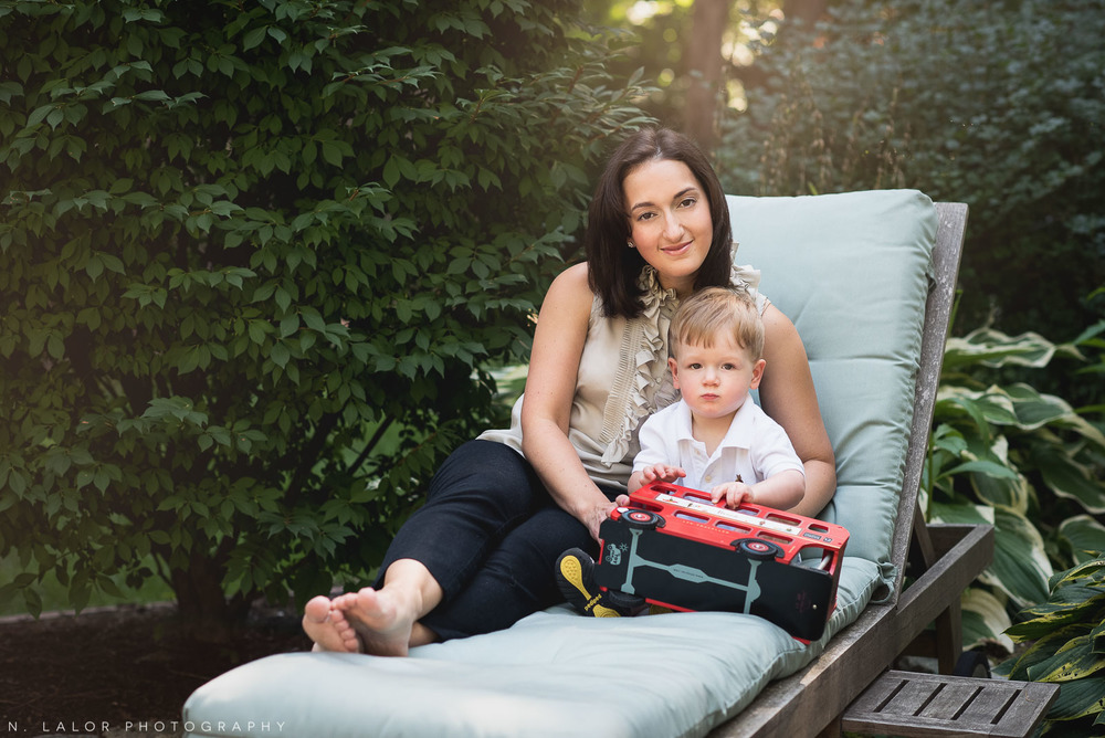 Mom enjoying the back yard with her toddler son. Naturally styled family photo by N. Lalor Photography.