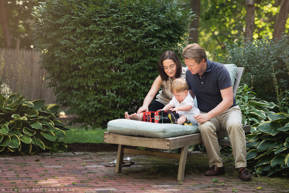 Parents playing with their toddler son in the back yard. Naturally styled family photo by N. Lalor Photography.