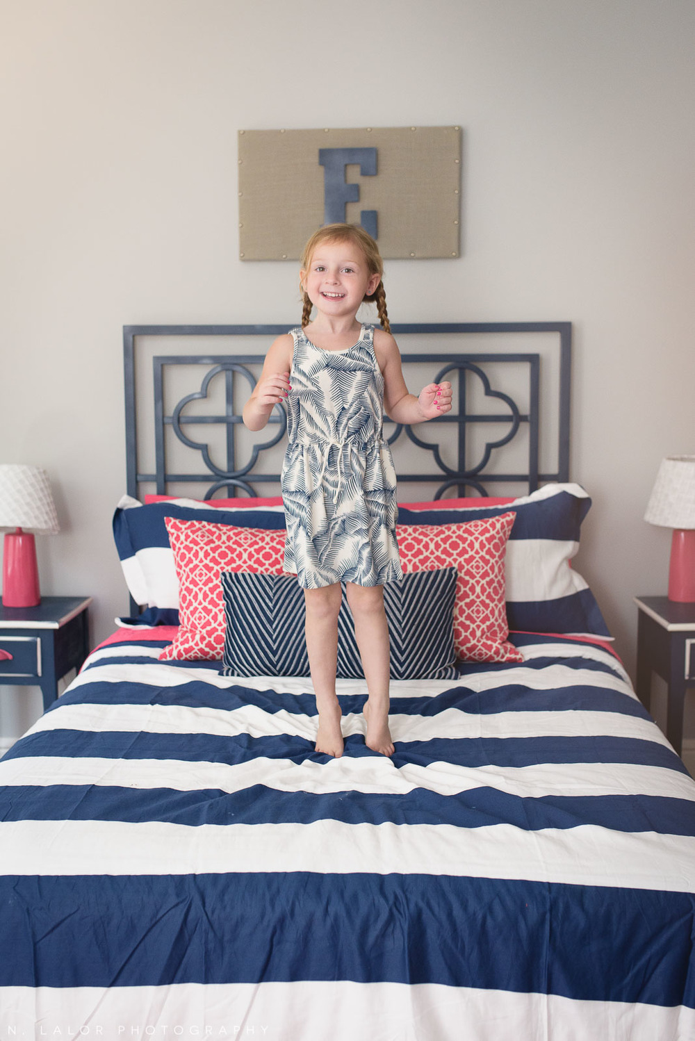 4-year old girl jumping on her bed. Lifestyle portrait by N. Lalor Photography.