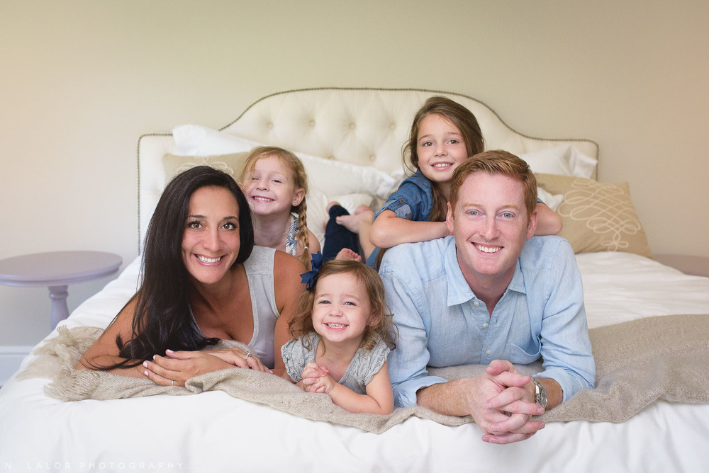 Naturally styled family photo of Mom, Dad, and their three girls by N. Lalor Photography.