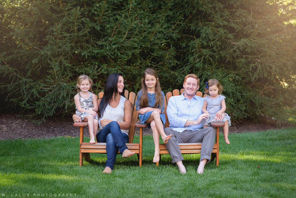 Naturally styled photo of a family of five, in their back yard. Lifestyle portrait by N. Lalor Photography.