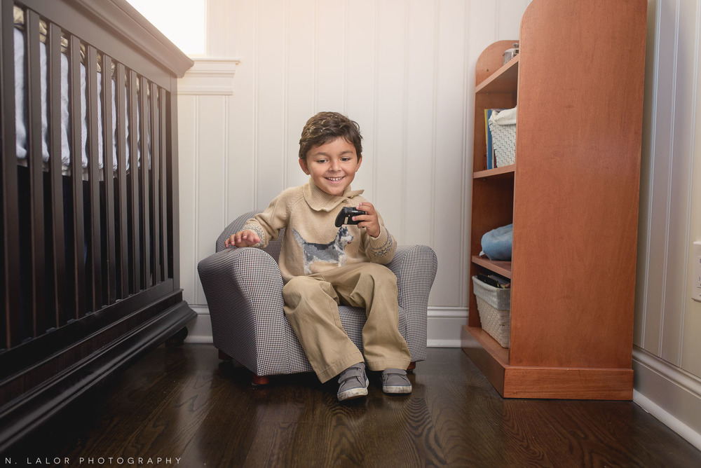 4-year old boy playing in his room. Lifestyle portrait by N. Lalor Photography.