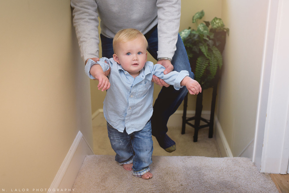 Walking up the stairs with Dad. 1-year old boy lifestyle portrait by N. Lalor Photography.