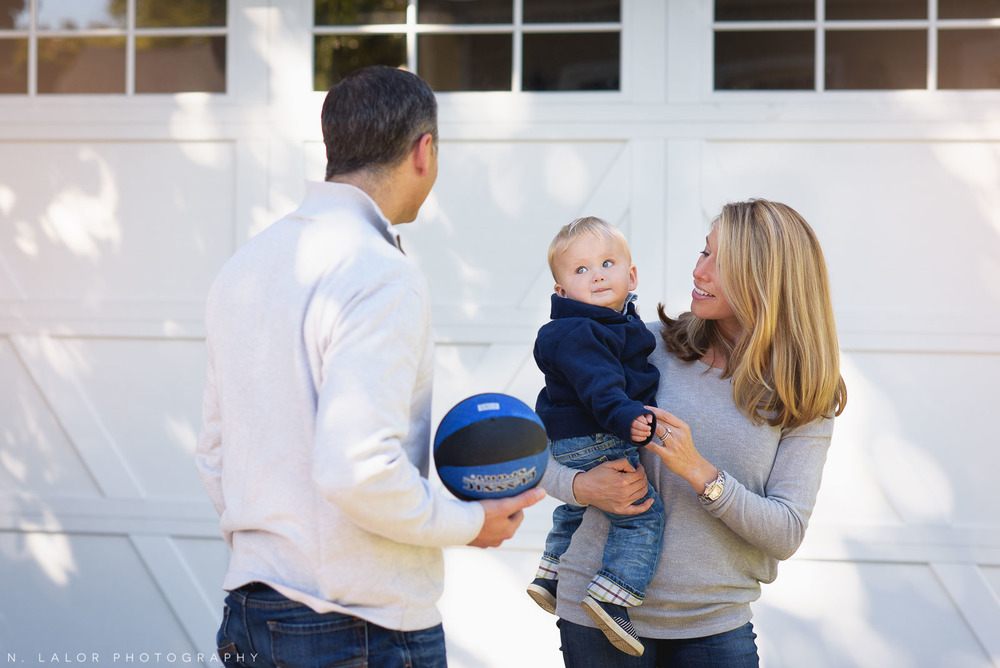 Favorite family activity - playing basketball in the back yard. Lifestyle family portrait by N. Lalor Photography.