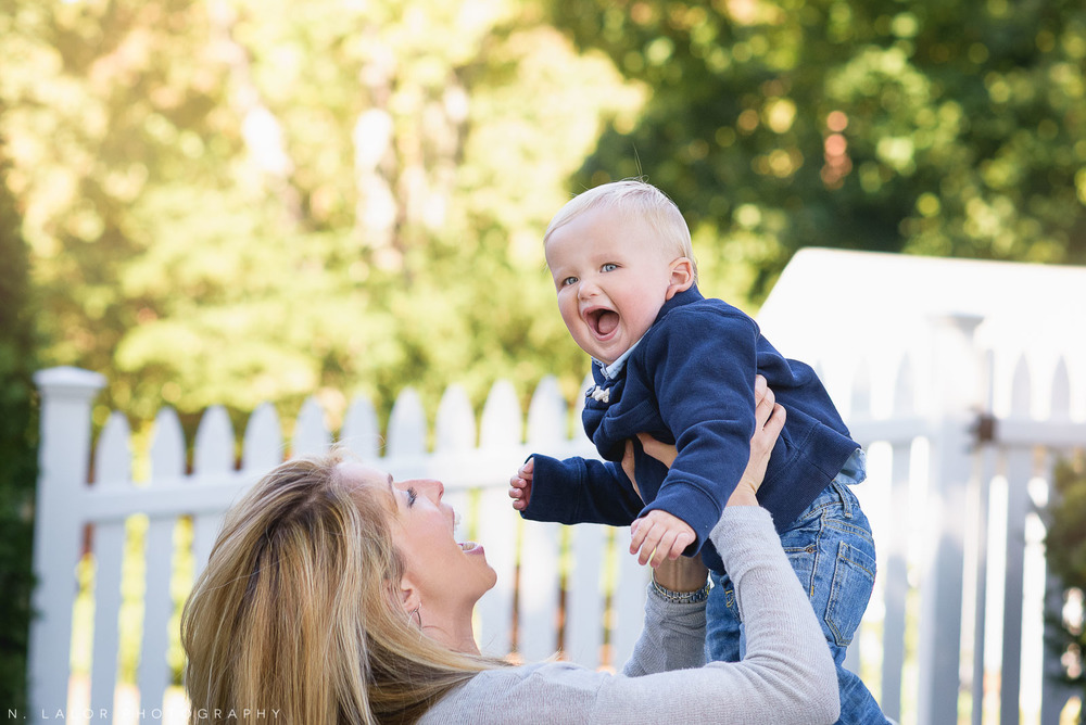 Mom laughing with her 1-year old son. Lifestyle portrait by N. Lalor Photography.