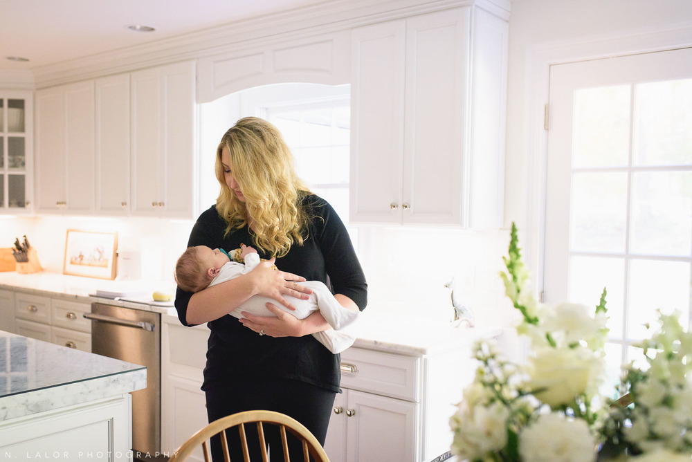 Mom with baby in her arms. In-home lifestyle portrait by N. Lalor Photography. Fairfield County, Connecticut.