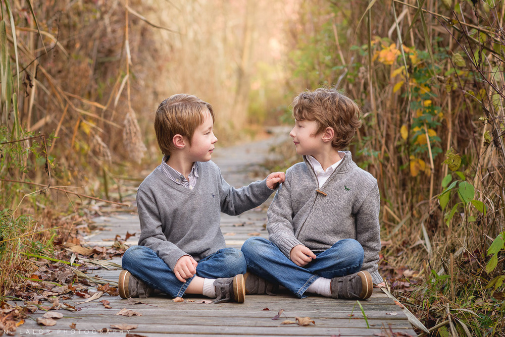 Twin brothers. Lifestyle portrait by N. Lalor Photography. New Canaan Nature Center.