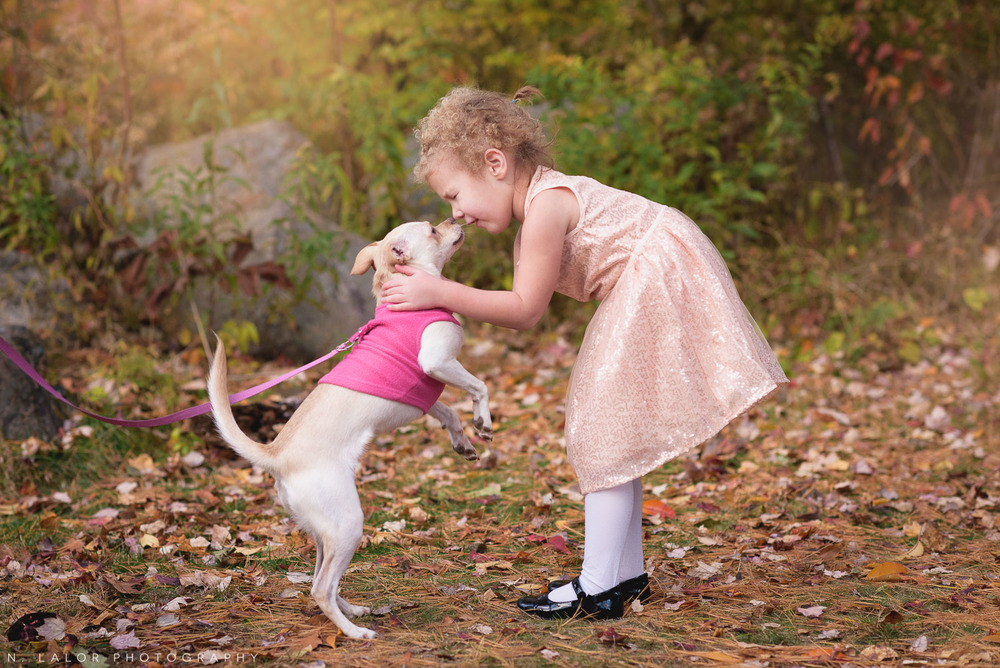 A girl and her dog. Lifestyle portrait by N. Lalor Photography. New Canaan Nature Center.