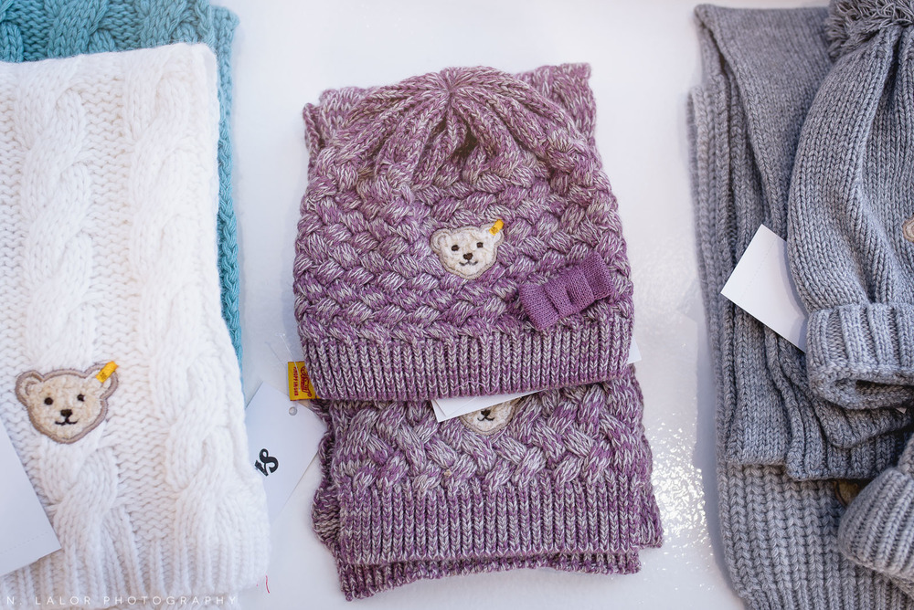 Adorable and warm winter accessories by Steiff at Ella & Henry in New Canaan. Photo by N. Lalor Photography.