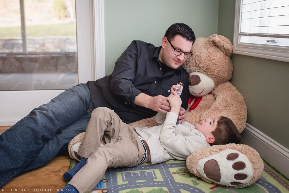 Dad and his son in the playroom. Casual family portrait by N. Lalor Photography.