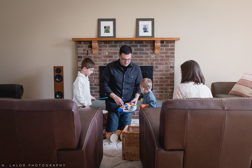 Family bonding over music in their living area. Lifestyle photo session by N. Lalor Photography.