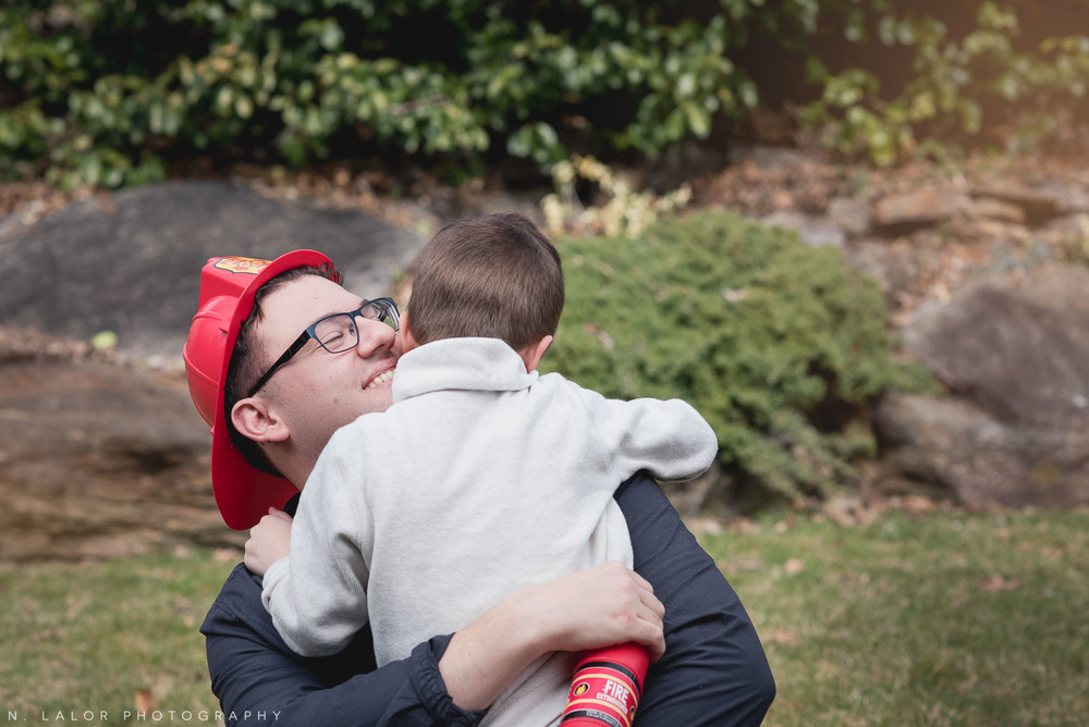 Dad hugging his oldest son. Photo by N. Lalor Photography. Fairfield County, CT photographer.