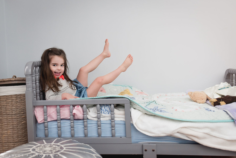 Being a 3-year old means jumping on the bed! Lifestyle family session by N. Lalor Photography. Greenwich, Connecticut.