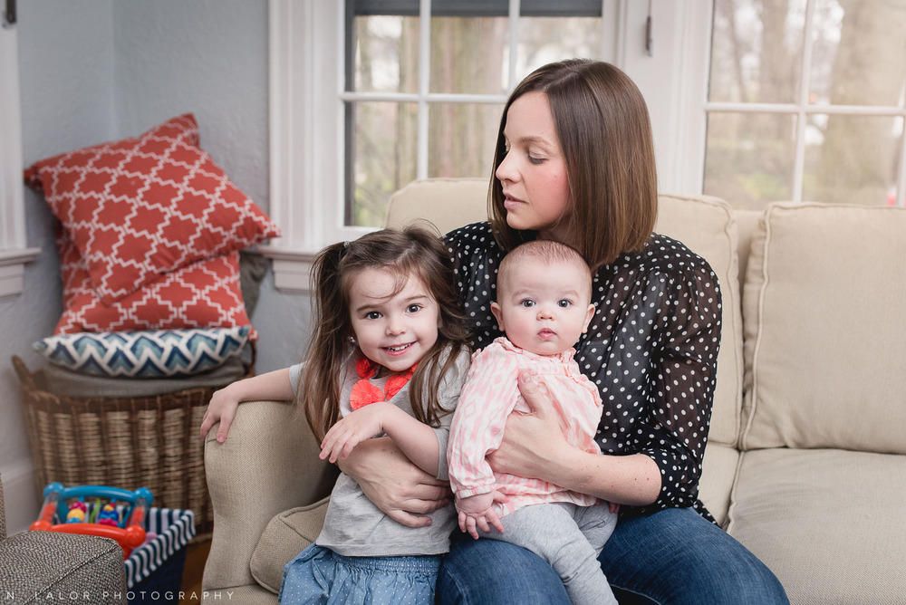 Mom with her two daughters at home. Casual family portrait by N. Lalor Photography.