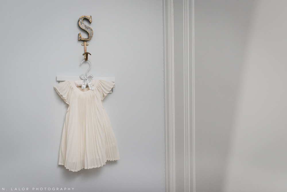A hanging dress detail in baby's room. Photo by N. Lalor Photography.