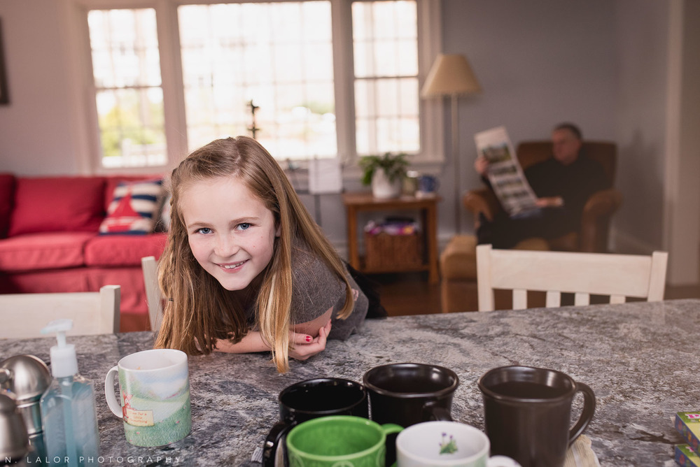 Real smiles from a 7-year old girl as she waits to dye some Easter eggs. Photo by N. Lalor Photography. Darien, CT.