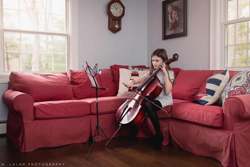 Playing the cello. Editorial-style portrait of a tween at home by N. Lalor Photography. Darien, Connecticut.