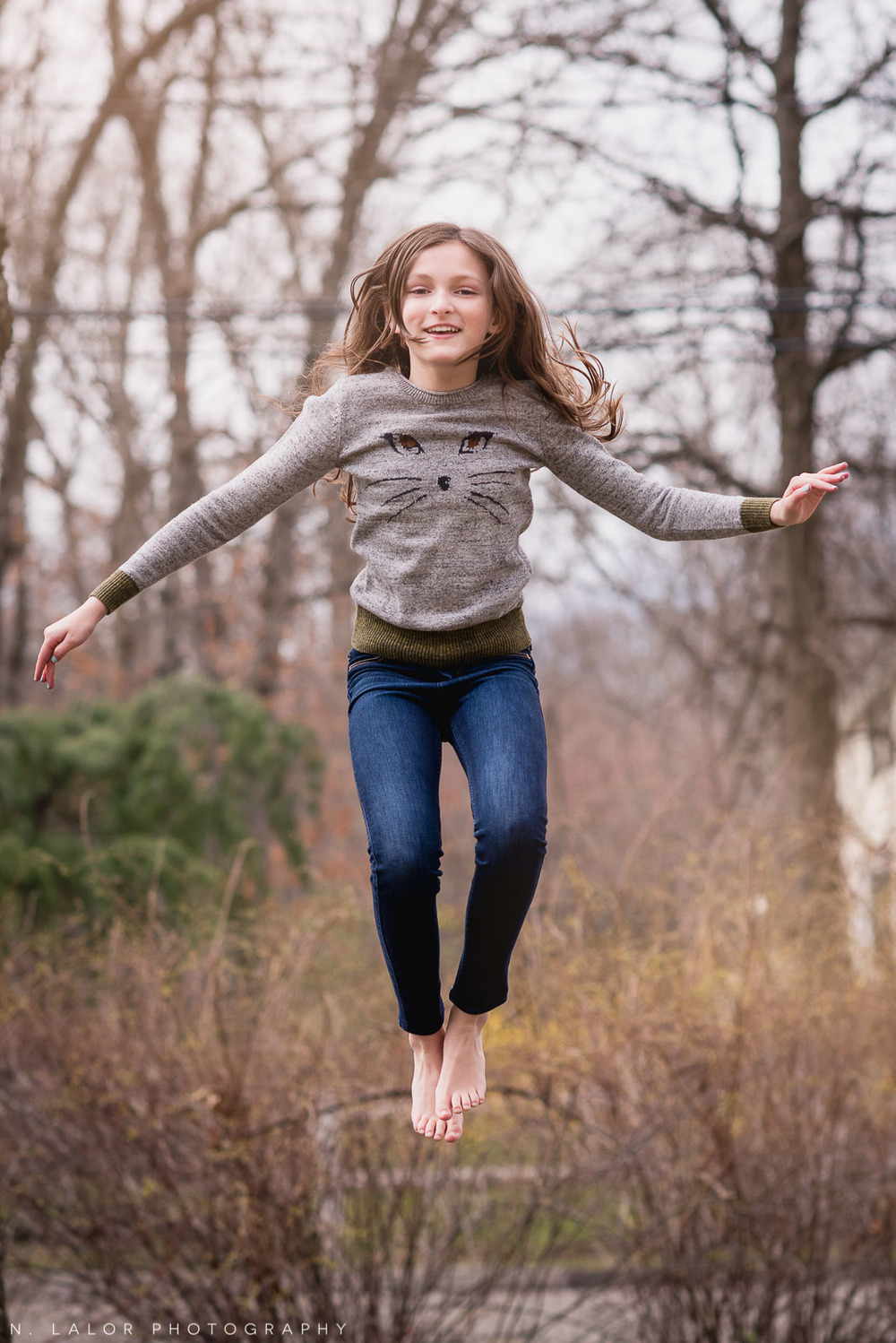 Flying through the air.. a portrait of a tween girl by N. Lalor Photography.