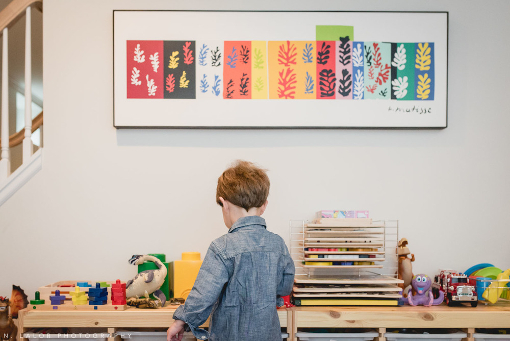 Grown-up art on the walls of a kids play room. Lifestyle interior shot by N. Lalor Photography.