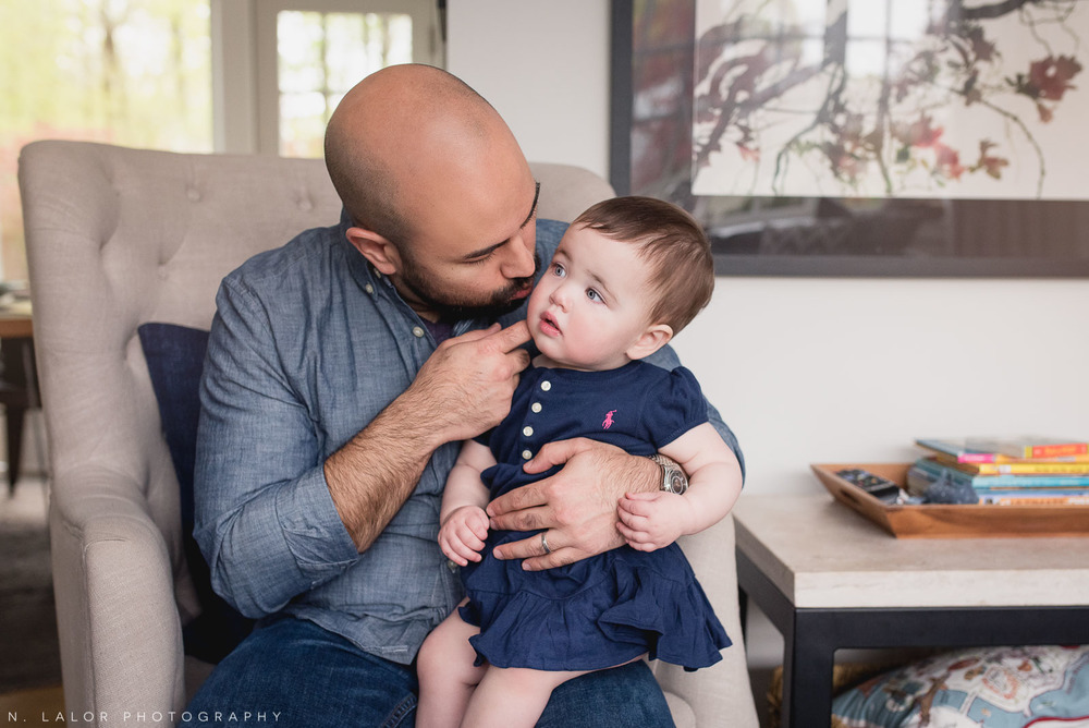 Sweet photo of dad and his 1-year old daughter. At-home family session with N. Lalor Photography.