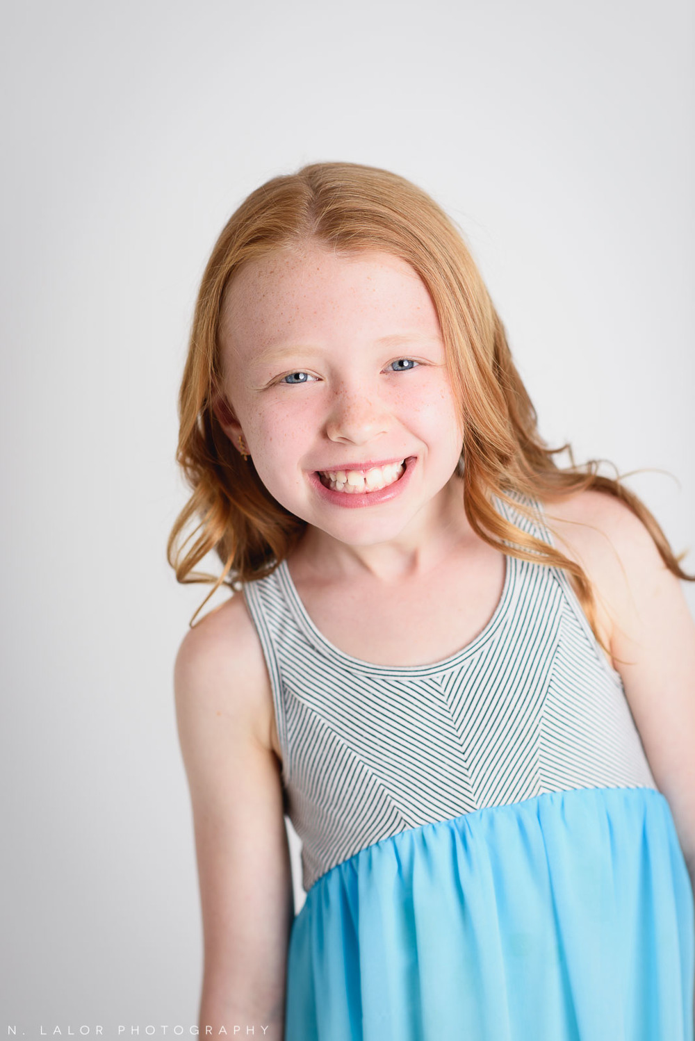 Editorial studio portrait of an 8-year old girl by N. Lalor Photography, located in Greenwich, Connecticut.