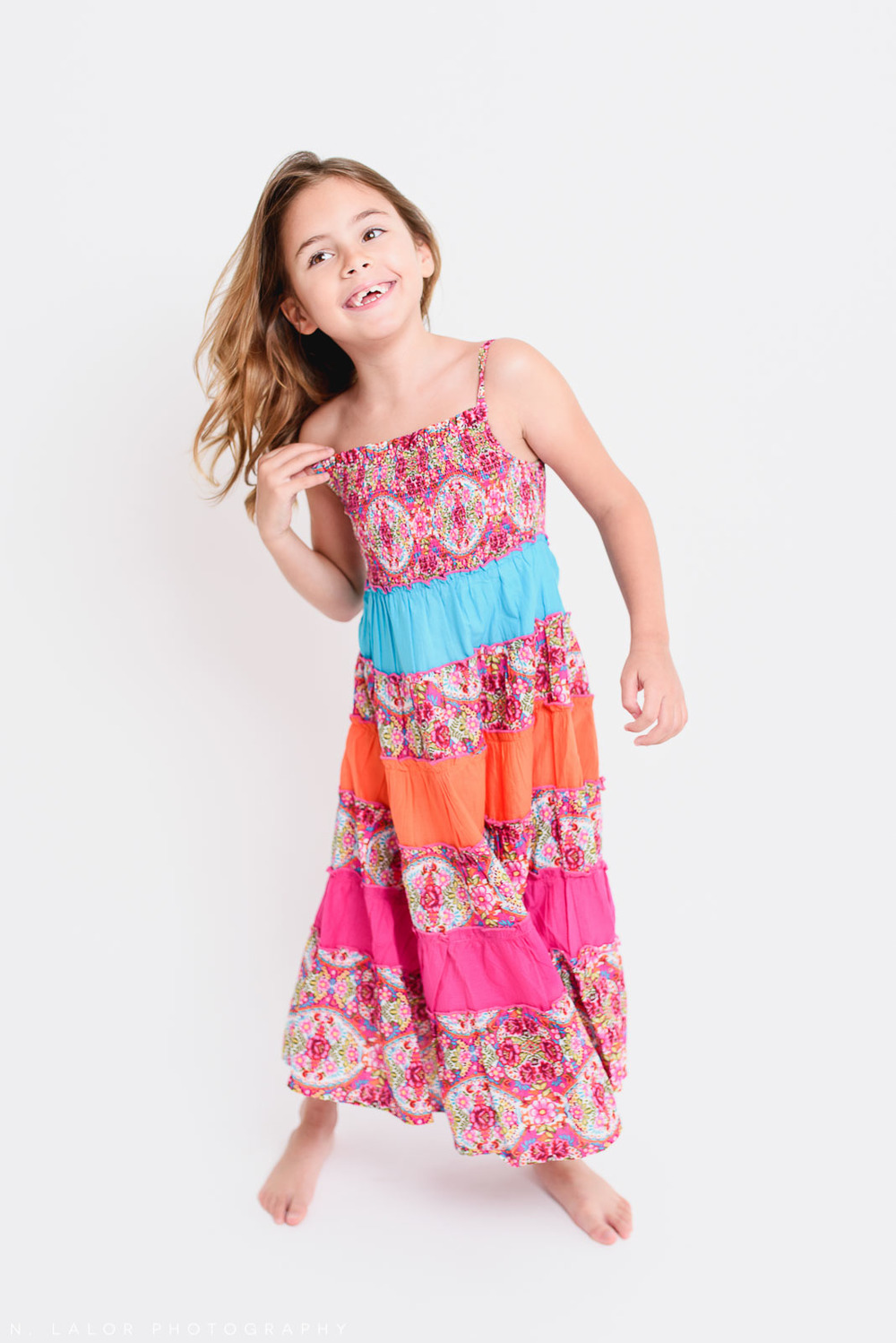 Summer dress. Editorial studio portrait of 6-year old girl by N. Lalor Photography in Greenwich, Connecticut.