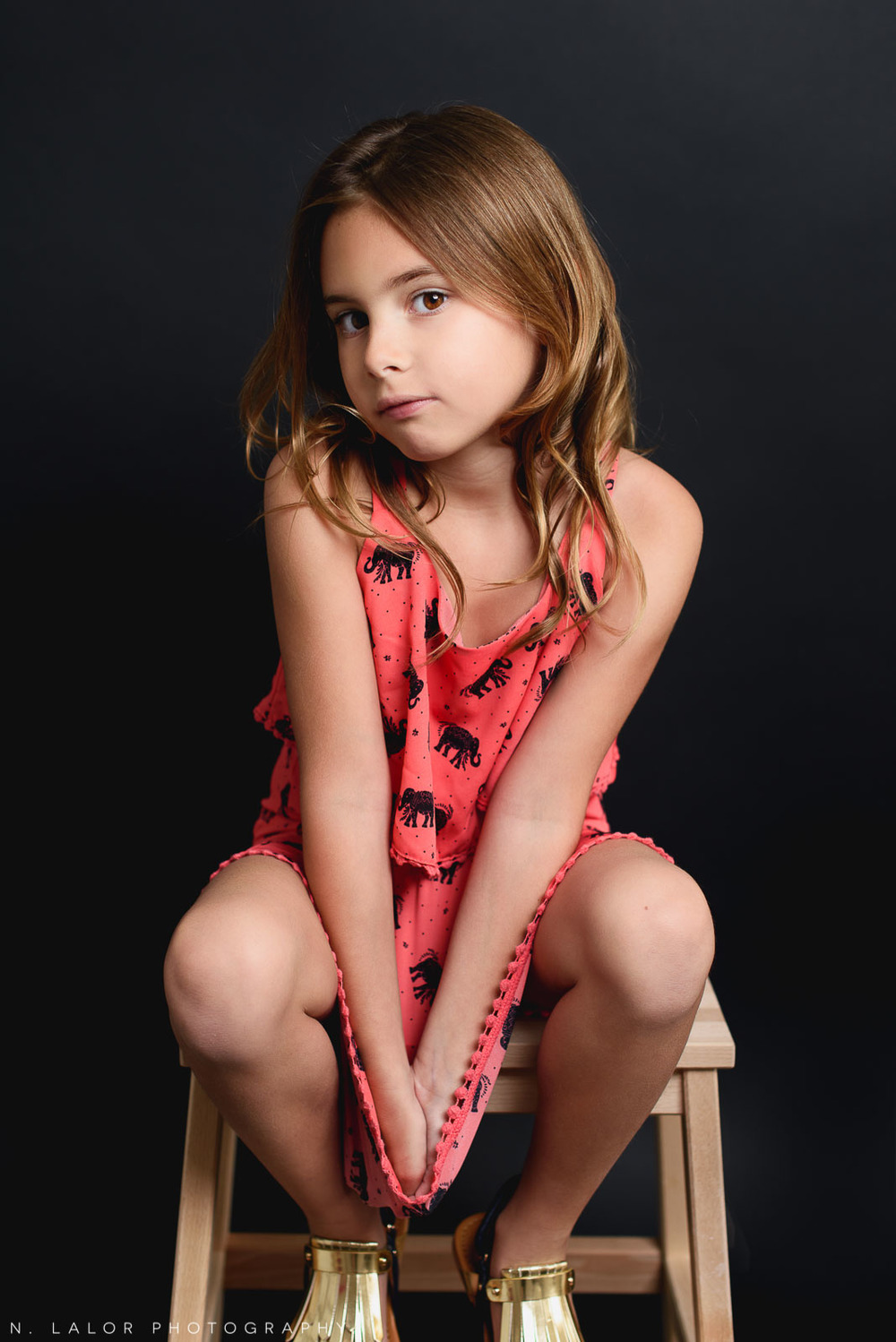 A moment of quiet. Editorial studio portrait of 6-year old girl by N. Lalor Photography in Greenwich, Connecticut.