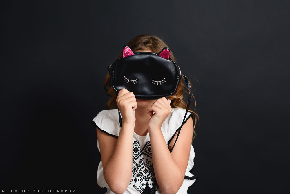 Kitty purse! Editorial studio portrait of 6-year old girl by N. Lalor Photography in Greenwich, Connecticut.