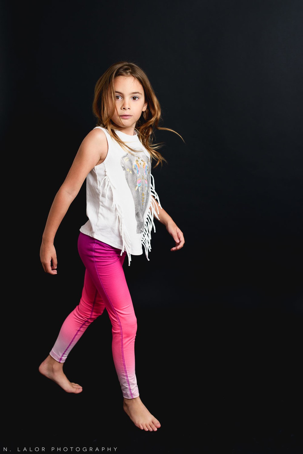 Walking the walk.. Editorial studio portrait of 6-year old girl by N. Lalor Photography in Greenwich, Connecticut.