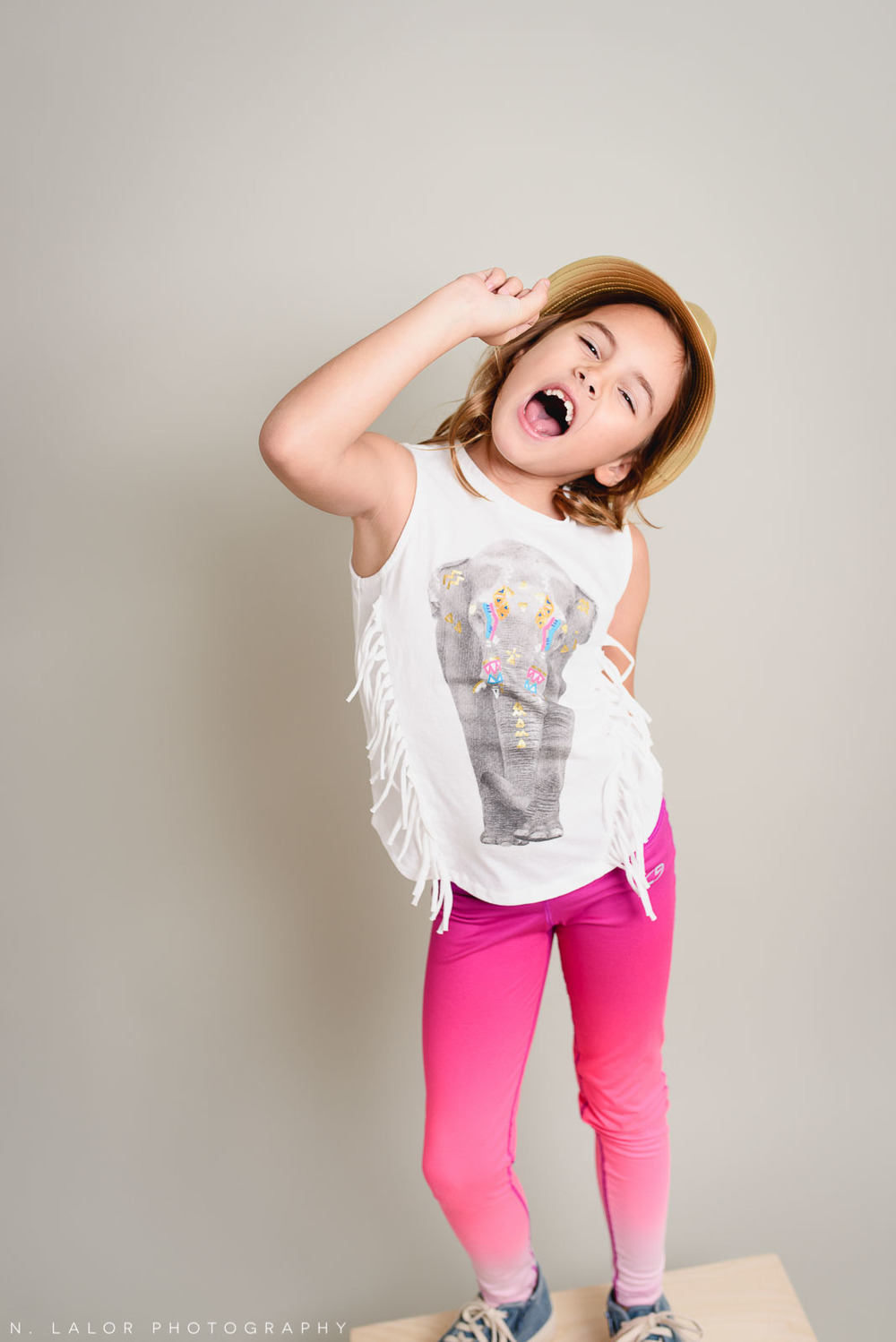 Rock and roll star! Editorial studio portrait of 6-year old girl by N. Lalor Photography in Greenwich, Connecticut.