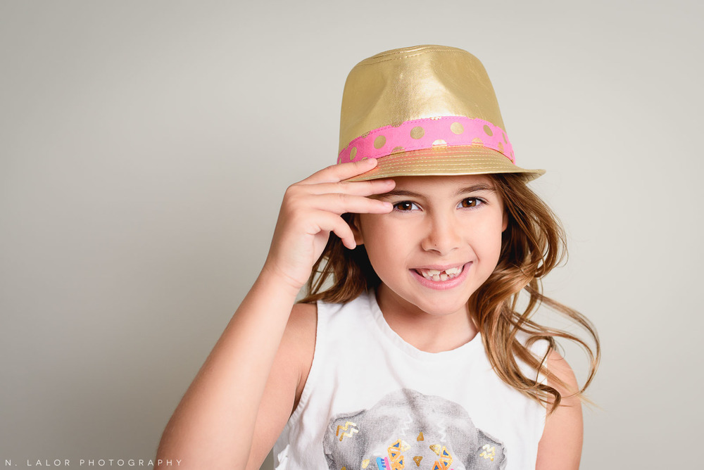 The most awesome gold hat! Editorial studio portrait of 6-year old girl by N. Lalor Photography in Greenwich, Connecticut.