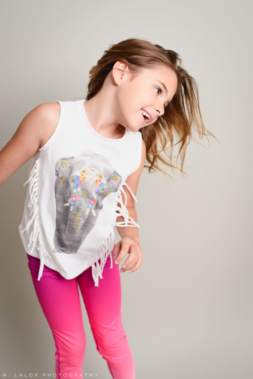 Movement. Editorial studio portrait of 6-year old girl by N. Lalor Photography in Greenwich, Connecticut.