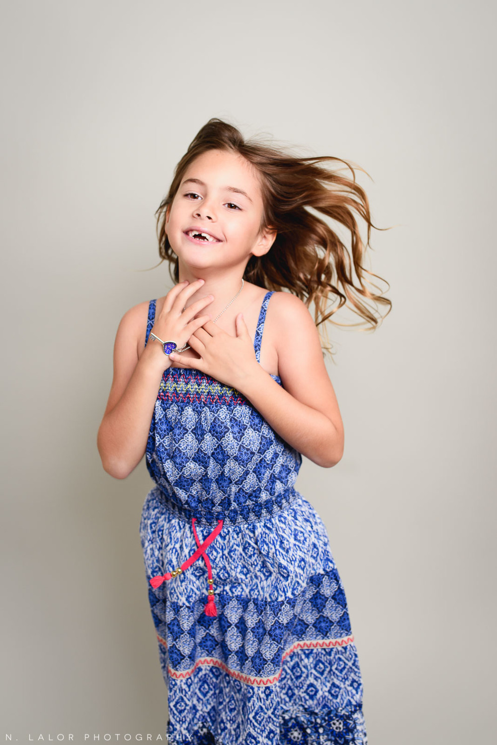 Mid-air. Editorial studio portrait of 6-year old girl by N. Lalor Photography in Greenwich, Connecticut.