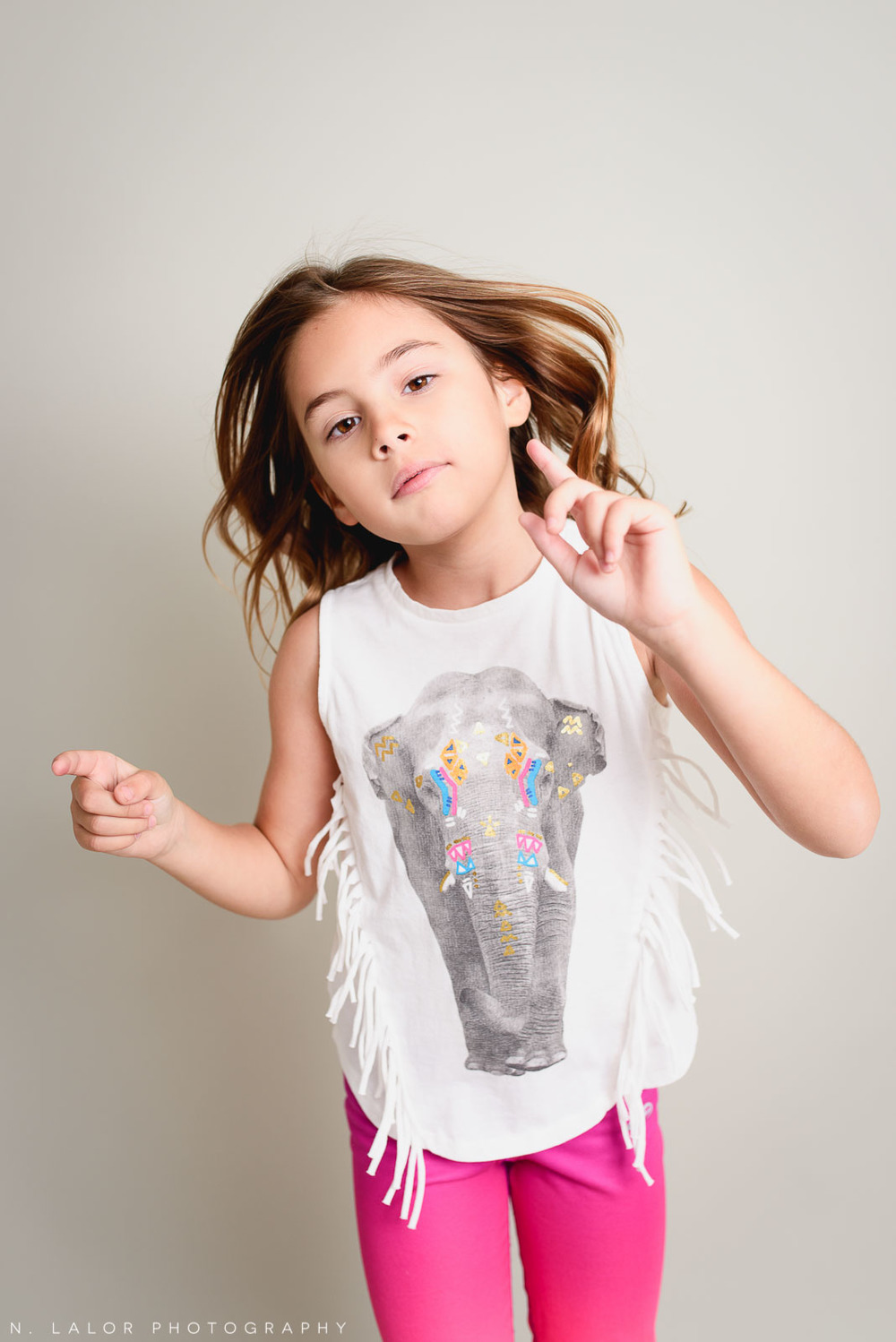 Attitude. Editorial studio portrait of 6-year old girl by N. Lalor Photography in Greenwich, Connecticut.
