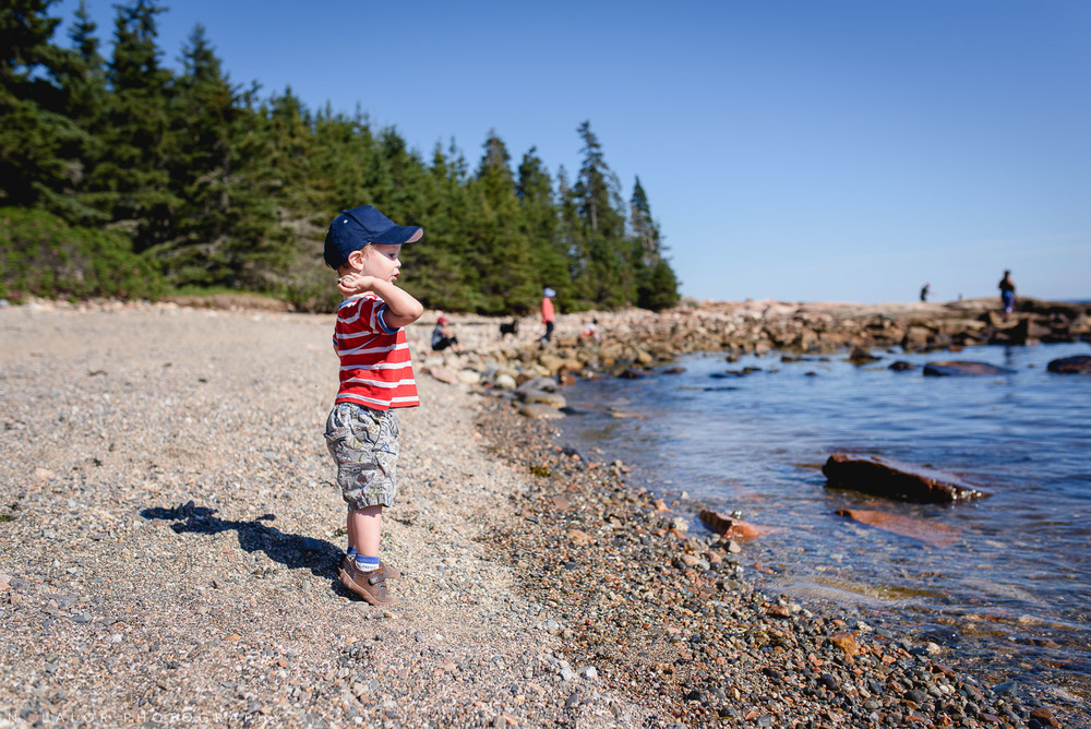 Throwing rocks. Acadia National Park in Bar Harbor Maine. Photo by N Lalor Photography.