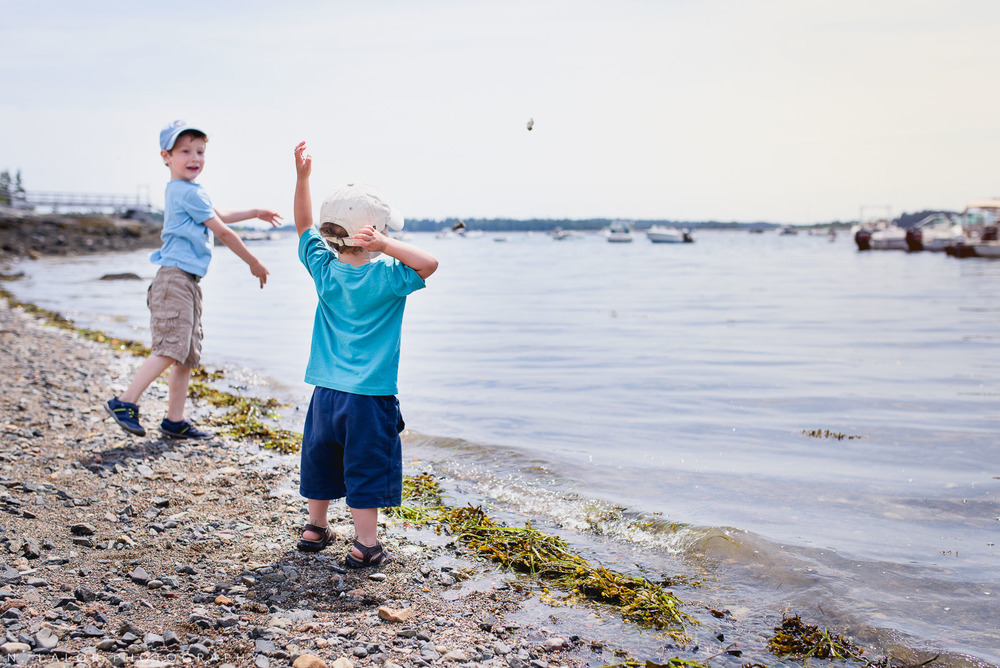 Throwing rocks into the water, they could do this all day. Little Cranberry Island, Maine. Photo by N Lalor Photography.
