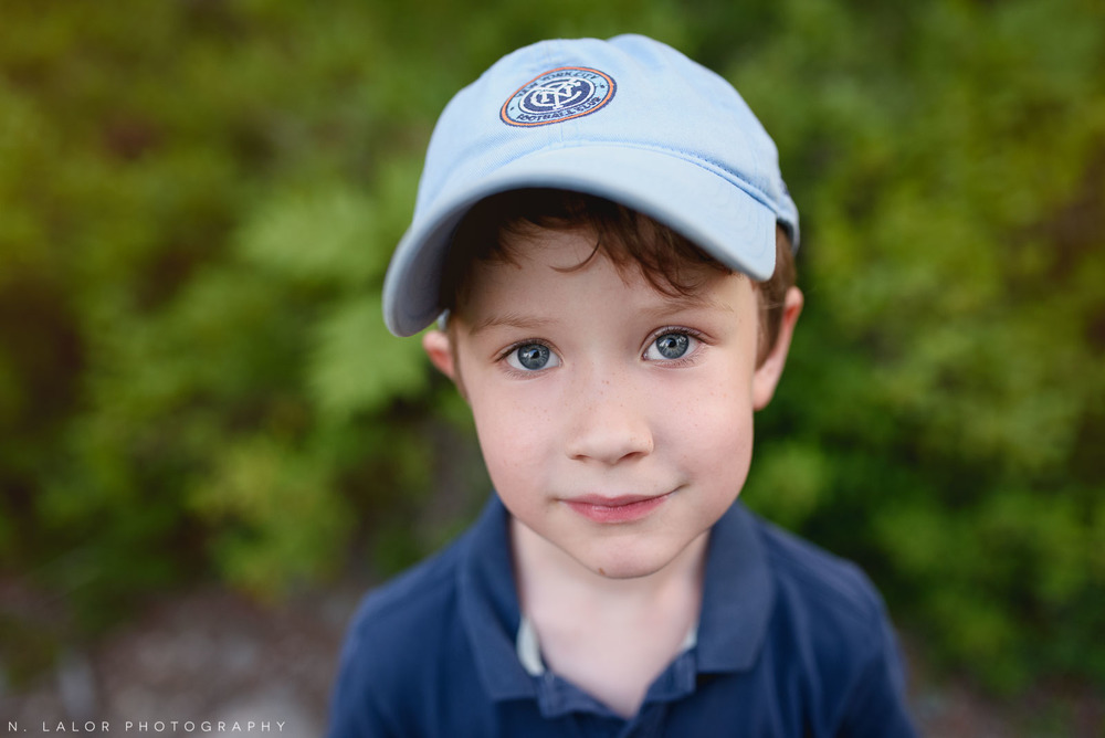 Portrait of a 6-year old boy. Acadia National Park in Bar Harbor Maine. Photo by N Lalor Photography.