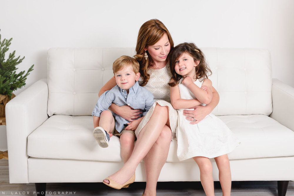 Mom with her children. Studio family mini sessions with N. Lalor Photography. Greenwich, Connecticut.