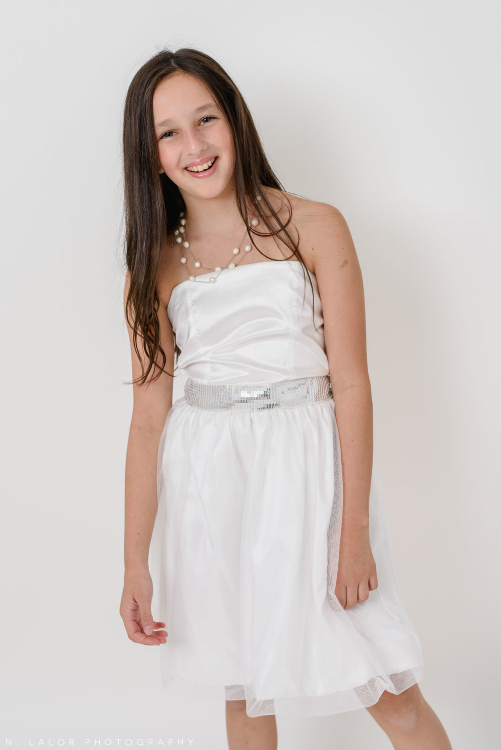 White dress. Stella M'Lia tween fashion photoshoot with N. Lalor Photography in Greenwich, Connecticut.