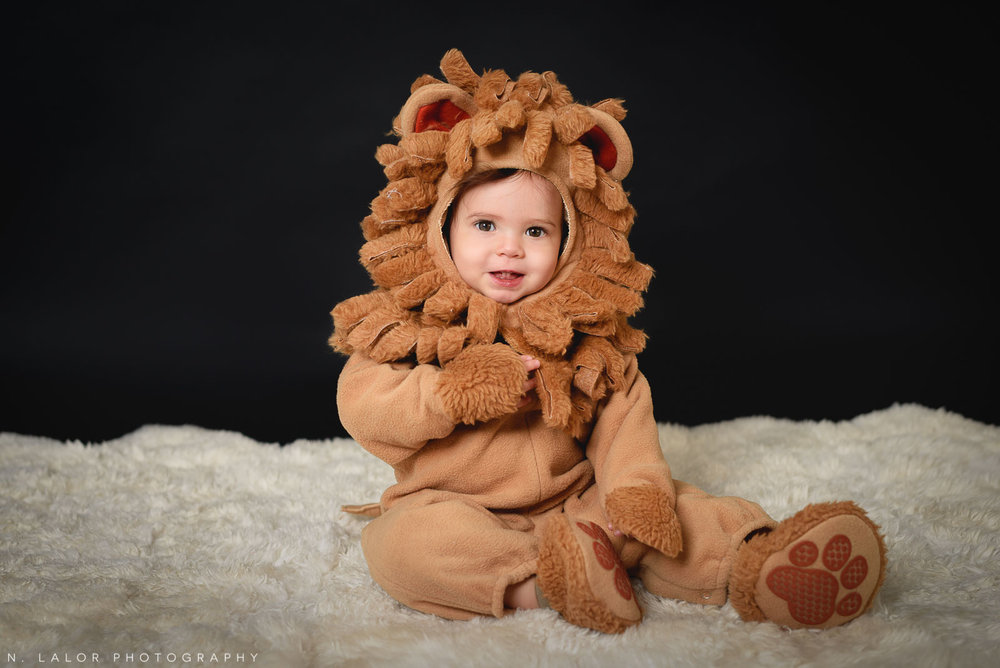 Little lion. PJ Masks. Kids Halloween costume portrait by N. Lalor Photography in Greenwich, Connecticut.