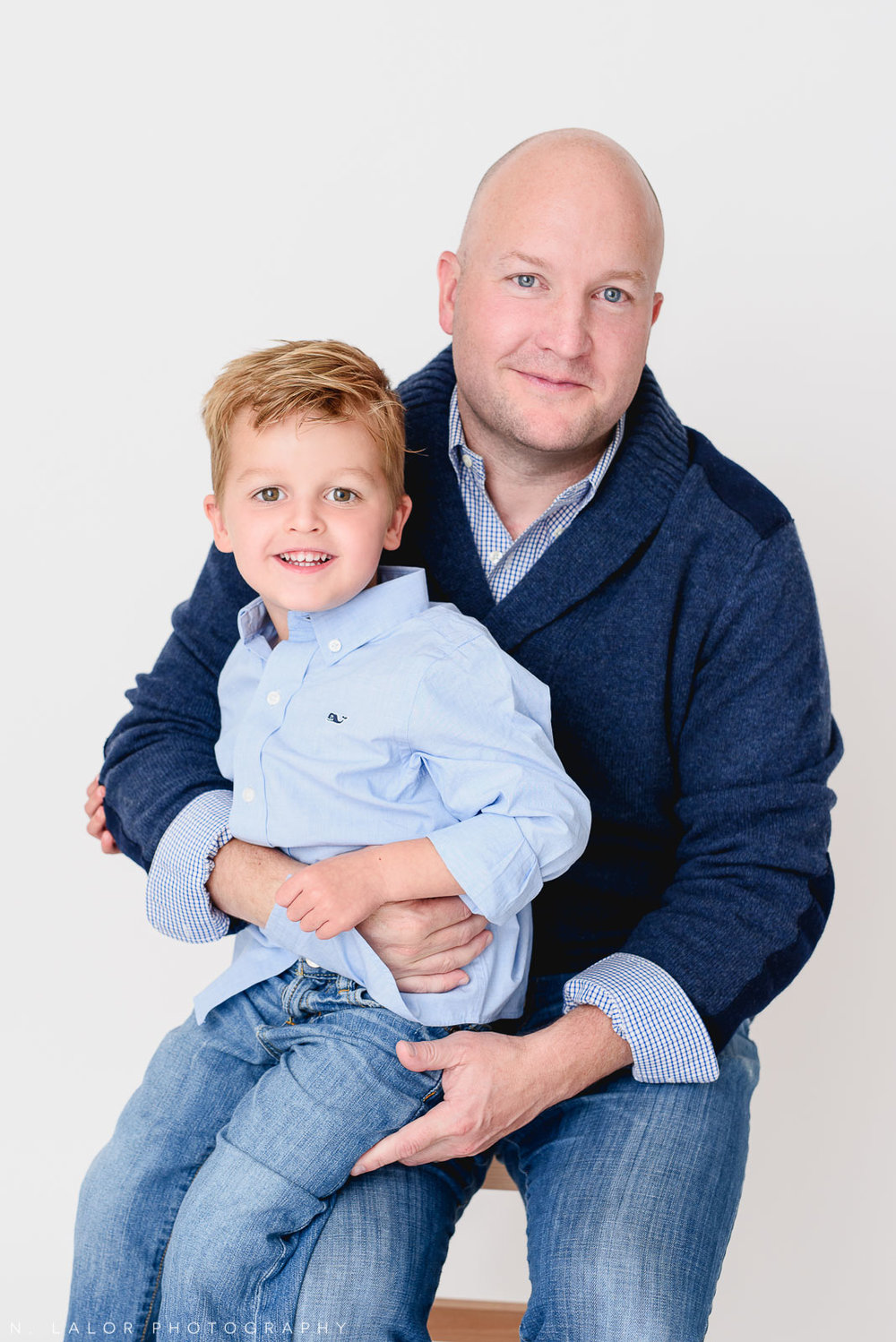 Dad with his son. Studio photo session with N. Lalor Photography. Greenwich, Connecticut.