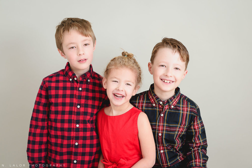 All three siblings. Greenwich CT Kids Photo Studio Portraits by N. Lalor Photography