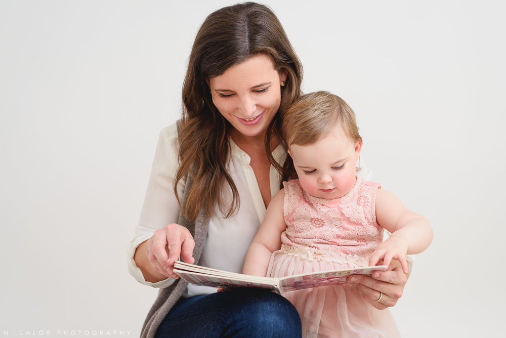 Little girl, reading with Mom. Portrait by N. Lalor Photography. Greenwich, CT
