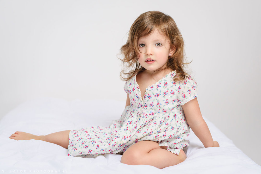 Luna, 2-years old. Simple studio portrait by N. Lalor Photography in Greenwich, Connecticut.