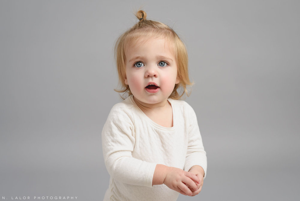 1 year old girl. Studio portrait by N. Lalor Photography, Greenwich CT family photographer.